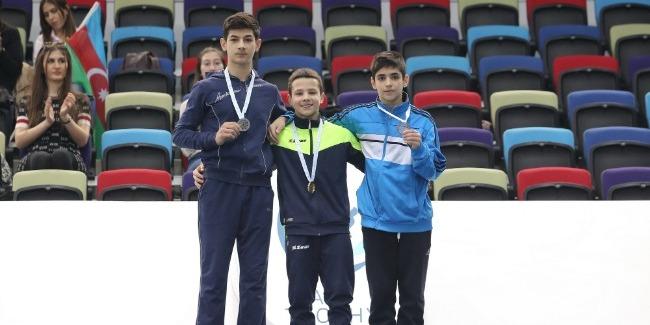 """Gimnastlarımız kişi idman gimnastikası üzrə 1-ci """"AGF Junior Trophy"""" yarışlarında yığma hesabına 3 medal yazdırdı"""
